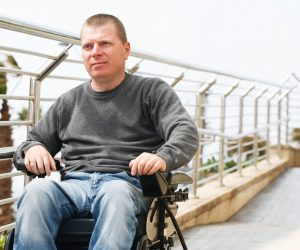 Man in wheelchair near the railing