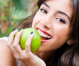 Teen biting an apple
