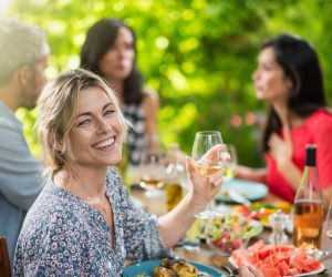 Woman sharing meal with friends