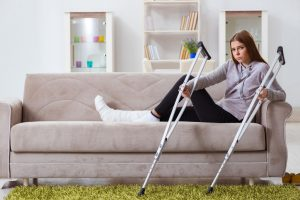 Young woman with injury and crutches