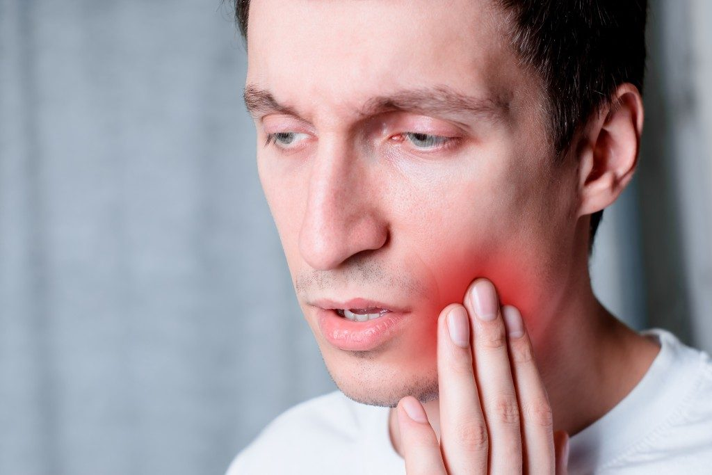 Man having a toothache