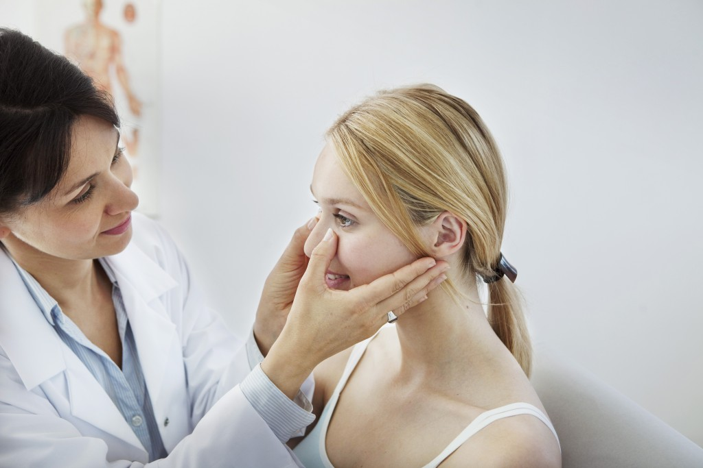 ENT doctor examining patient