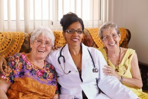 Doctor with two old women