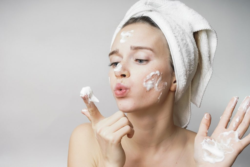 Woman with soap on face