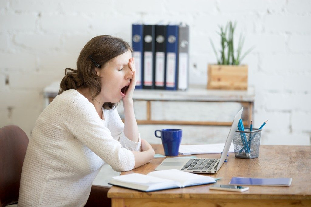 fatigued employee yawning