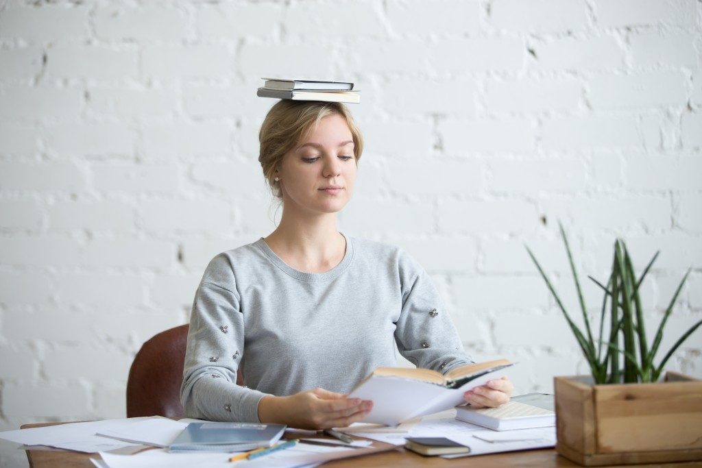 Woman with books on her head