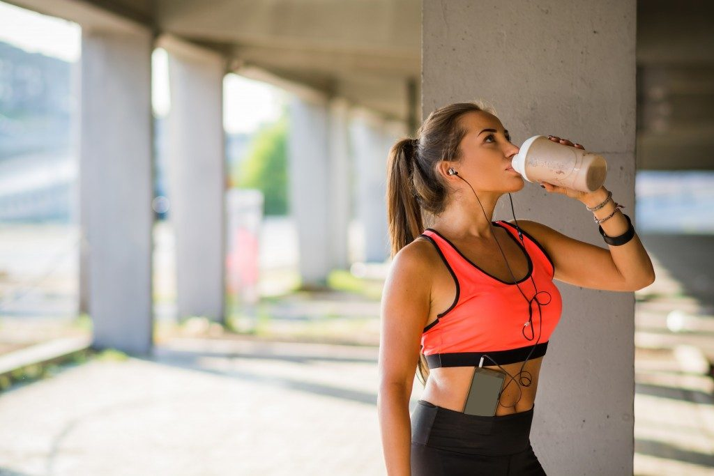 Woman having her protein drink