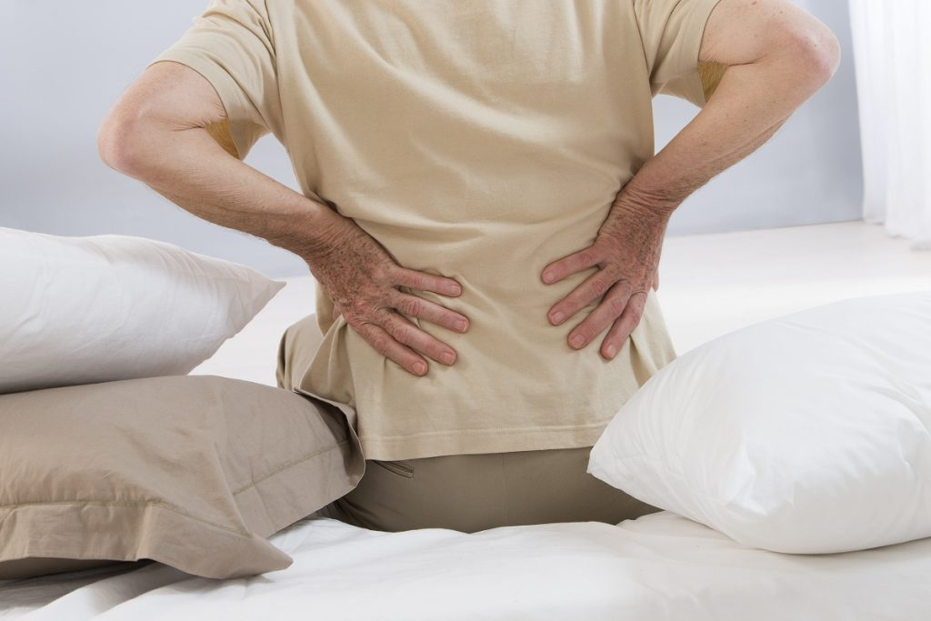 Elderly feeling back pain