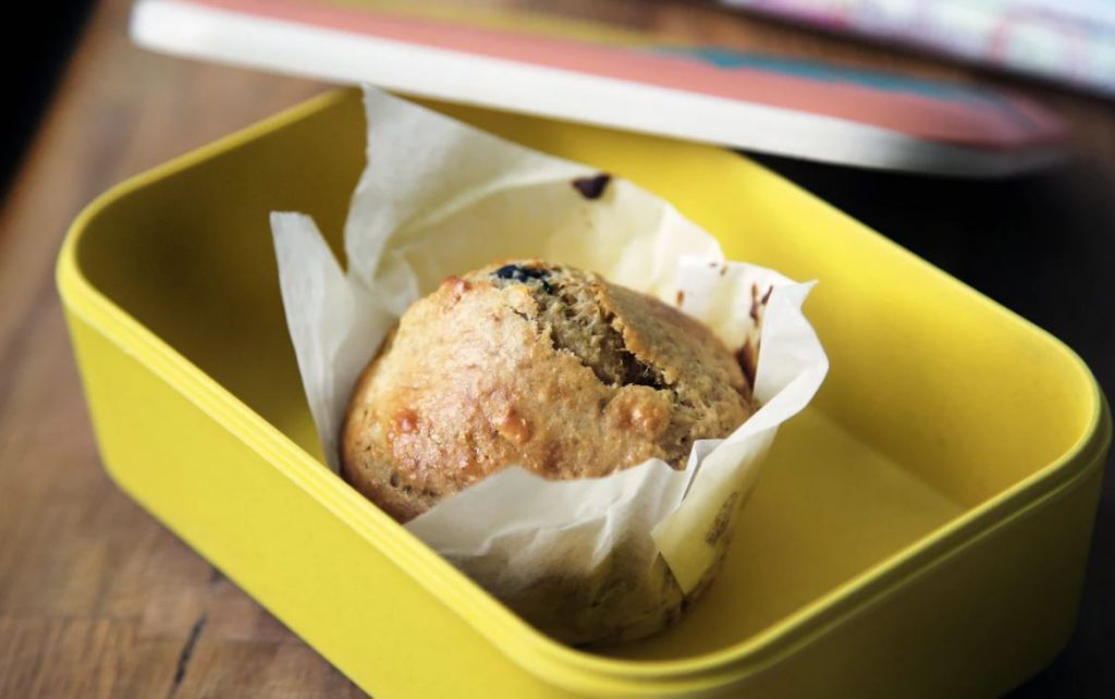muffin on yellow plastic container