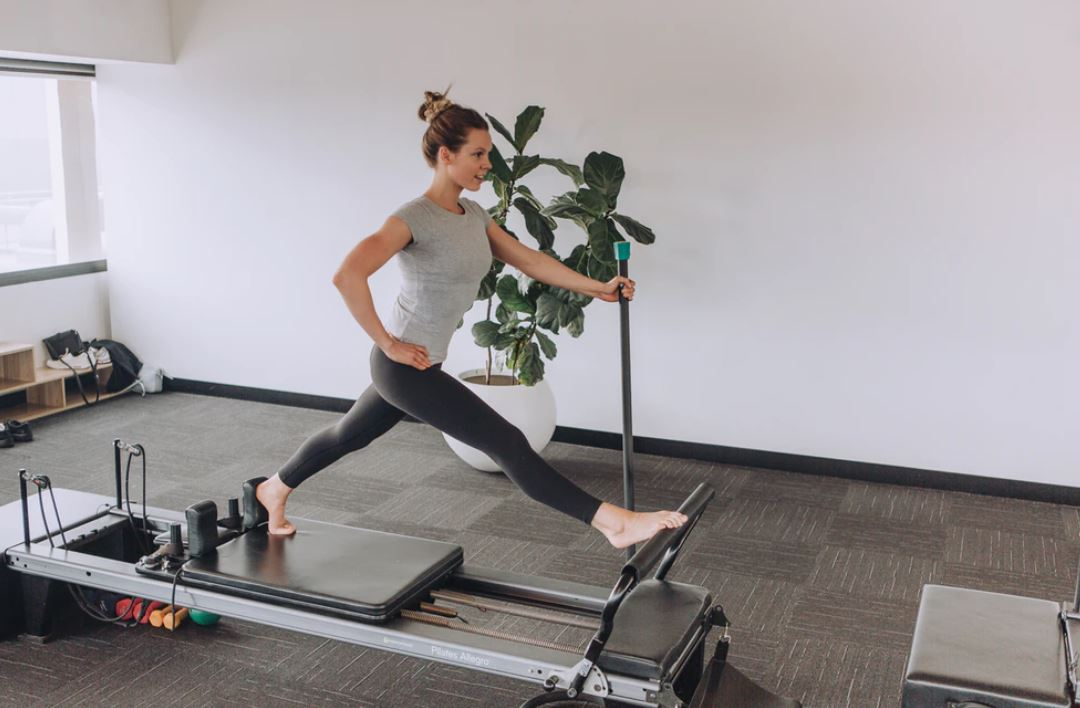 woman exercising using equipment