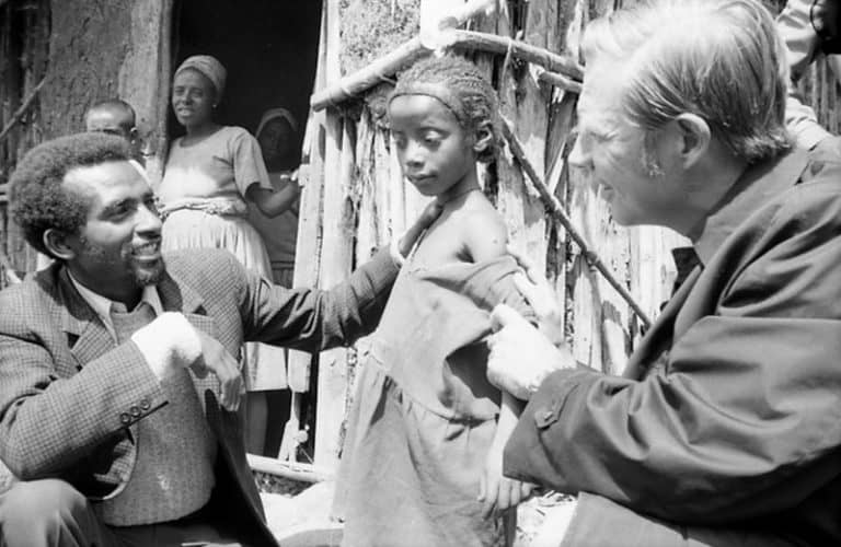 men treating a child with smallpox