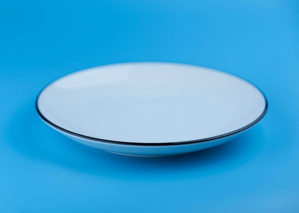 clean plate on blue background