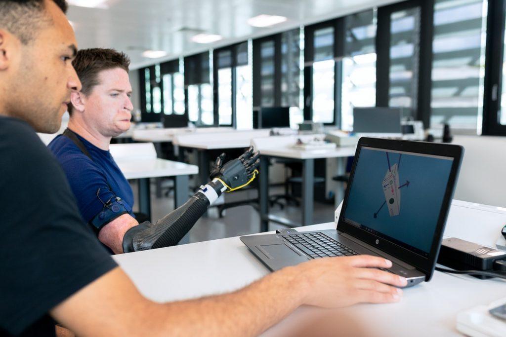 engineer developing prosthetic arm