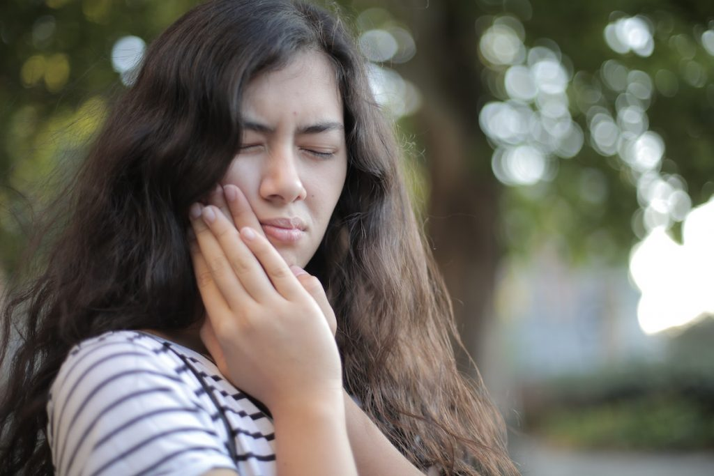 woman experiencing a toothache