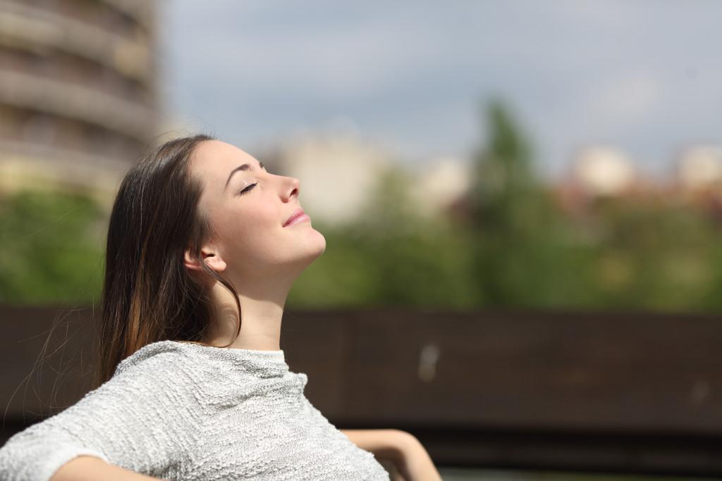 woman relaxing under summer sun